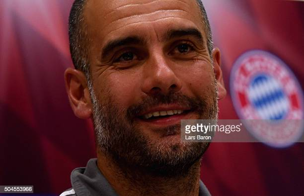 Head coach Josep Guardiola smiles during a press conference at day six of the Bayern Muenchen training camp at Aspire Academ on January 11 2016 in...