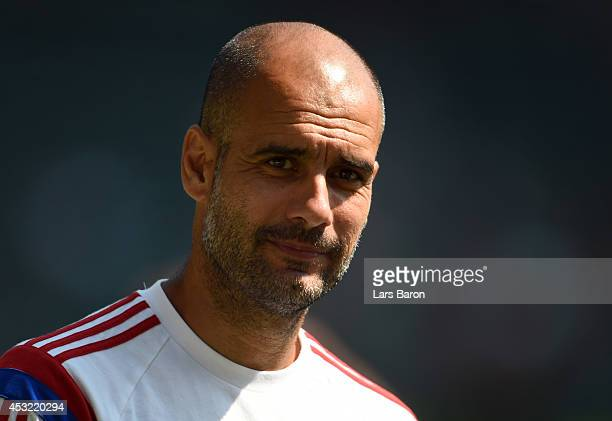 Head coach Josep Guardiola smiles during a training session at the JeldWen Field on day seven of the Bayern Muenchen Audi Summer Tour USA 2014 on...