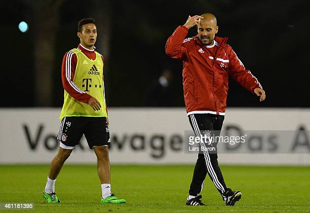 Head coach Josep Guardiola speaks with Thiago during a training session at day 3 of the Bayern Muenchen training camp at ASPIRE Academy for Sports...