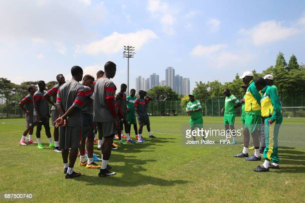 Head coach Joseph Koto talks to the team before a training session ahead of the FIFA U20 World Cup Korea Republic 2017 group F match against USA at...