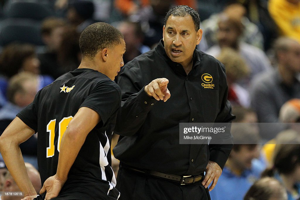 Head Coach Joseph Price of the Grambling State Tigers talks to Chase Comier #10 during the first half against the Marquette Golden Eagles at BMO Harris Bradley Center on November 12, 2013 in Madison, Wisconsin.