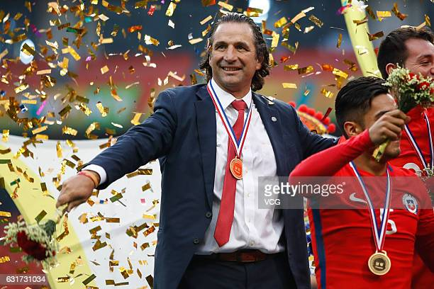 Head coach Juan Antonio Pizzi of Chile celebrates during the awards ceremony after winning the final match against Iceland during 2017 Gree China Cup...