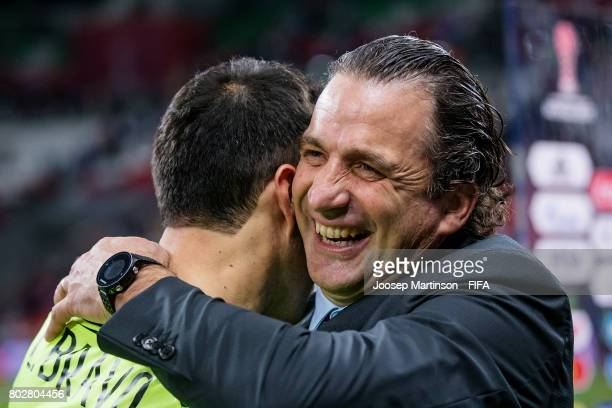 Head coach Juan Antonio Pizzi of Chile congratulates Claudio Bravo of Chile after FIFA Confederations Cup Russia semifinal match between Portugal and...