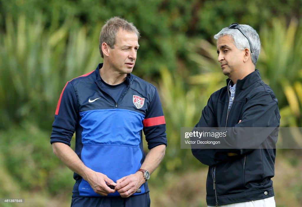 Head Coach Juergen Klinsmann of the U.S. Men's National Soccer team (L) and United States Soccer Federation President Sunil Gulati attend training at StubHub Center on January 7, 2014 in Los Angeles, California.