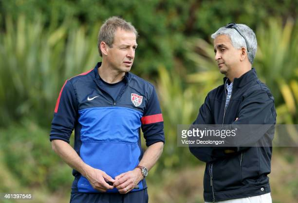 Head Coach Juergen Klinsmann of the US Men's National Soccer team and United States Soccer Federation President Sunil Gulati attend training at...