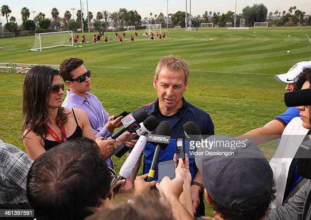 Head Coach Juergen Klinsmann of the US Men's National Soccer team speaks to the media prior to training at StubHub Center on January 7 2014 in Los...