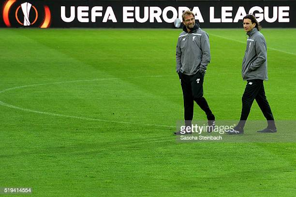 Head coach Juergen Klopp and assistant coach Zeljko Buvac attend the Liverpool FC training session prior to the UEFA Europa League match between...