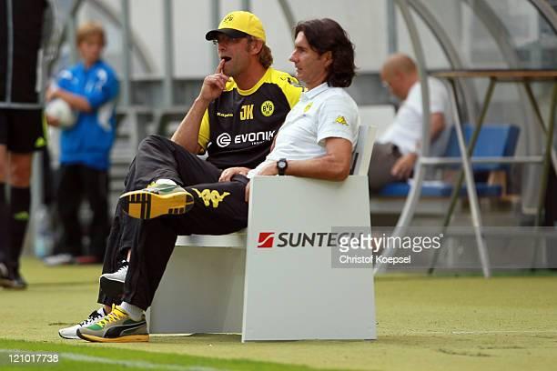 Head coach Juergen Klopp and assistant coach Zeljko Buvac of Dortmund sit on the bench during the Bundesliga macht between TSG 1899 Hoffenheim and...