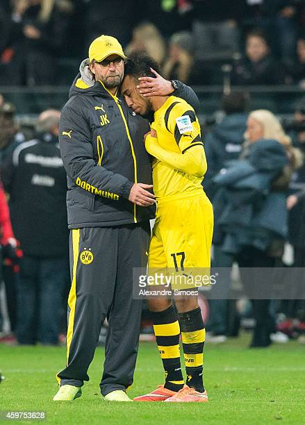 Head coach Juergen Klopp and his player PierreEmerick Aubameyang of Dortmund look dejected after the final whistle during the Bundesliga match...