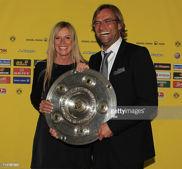 Head coach Juergen Klopp and his wife Ulla Klopp pose with the German Championship trophy during the dinner to celebrate their German Bundesliga...