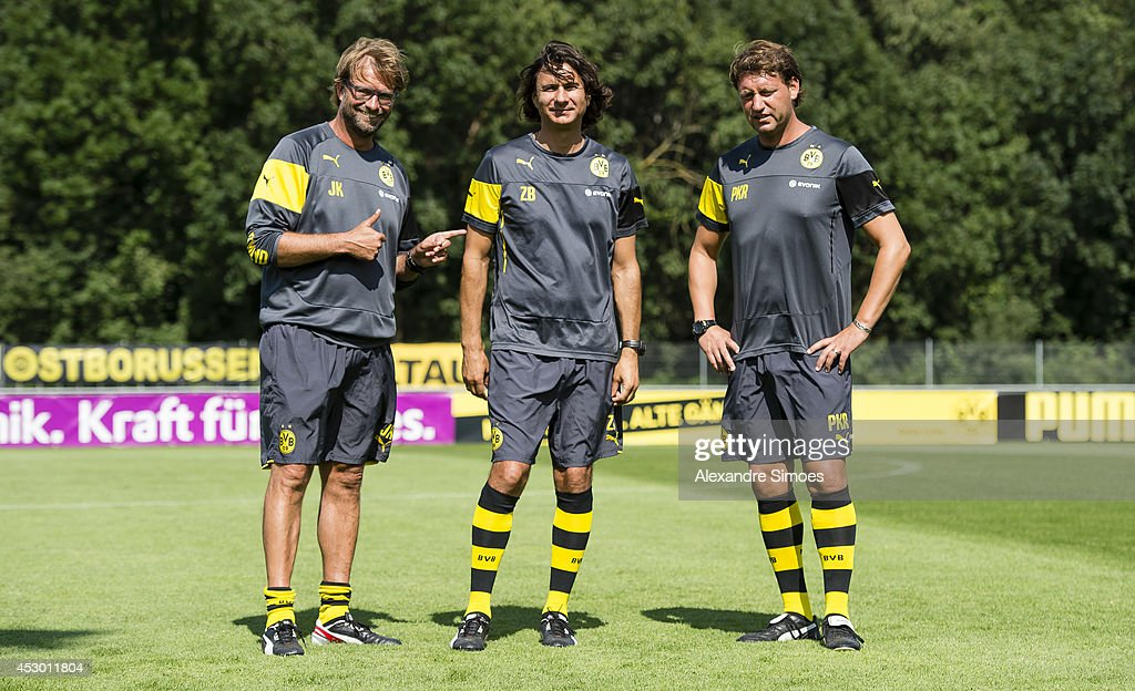 Head coach Juergen Klopp (BVB) , assistant coach Zeljko Buvac (BVB) and assistant coach <a gi-track='captionPersonalityLinkClicked' href=/galleries/search?phrase=Peter+Krawietz&family=editorial&specificpeople=5443720 ng-click='$event.stopPropagation()'>Peter Krawietz</a> (BVB) of Borussia Dortmund during a training session in the Borussia Dortmund training camp on July 31, 2014 in Bad Ragaz, Switzerland.