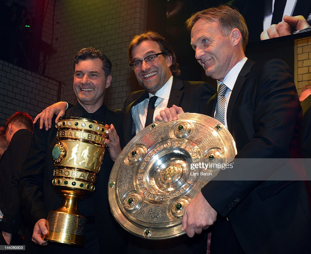 Head coach Juergen Klopp (C) celebrates with manager Michael Zorc (L) and managing director Hans Joachim Watzke (R) during the Borussia Dortmund party at the Ewerk on May 13, 2012 in Berlin, Germany.