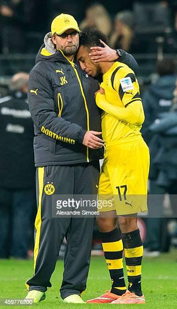 Head coach Juergen Klopp consoles PierreEmerick Aubameyang of Dortmund after the final whistle in the Bundesliga match between Eintracht Frankfurt...