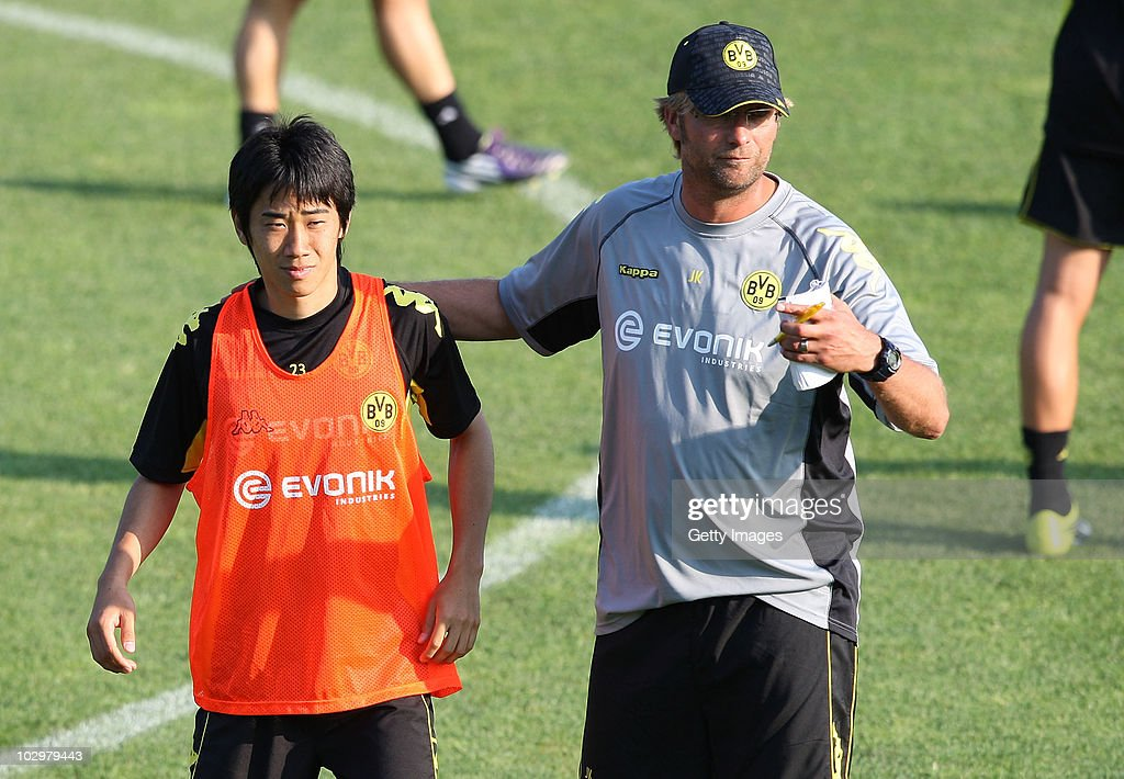 Head coach Juergen Klopp embraces Shinji Kagawa during the Borussia Dortmund Training Camp for the upcoming season 2010/2011 on July 19 2010 in...