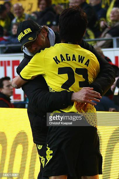 Head coach Juergen Klopp embraces Shinji Kagawa of Dortmund after scoring the second goal during the 1 Bundesliga match between Borussia Dortmund an...