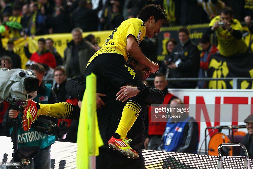 Head coach Juergen Klopp embraces Shinji Kagawa of Dortmund after scoring the second goal during the 1 Bundesliga match between Borussia Dortmund an...