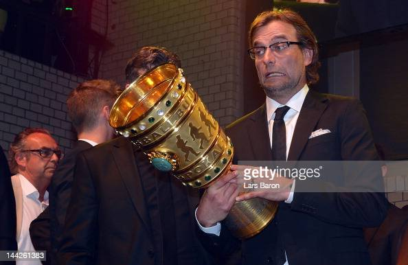 Head coach Juergen Klopp is seen with the cup during the Borussia Dortmund party at the Ewerk on May 13 2012 in Berlin Germany