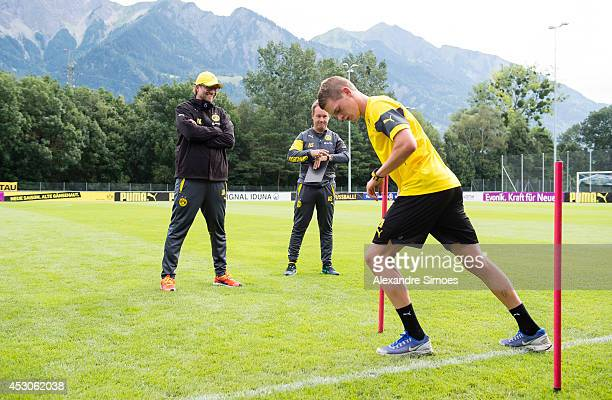 Head coach Juergen Klopp Leiter Athletik Dr Andreas Schlumberger und Matthias Ginter of Borussia Dortmund during a training session on August 2 2014...