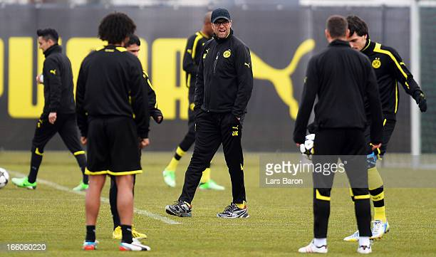 Head coach Juergen Klopp looks on during a Borussia Dortmund training session ahead of their UEFA Champions League quarterfinal match against Malaga...