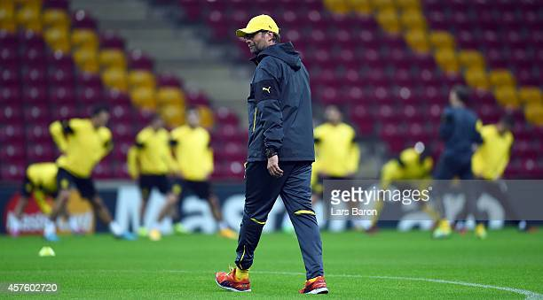 Head coach Juergen Klopp looks on during a Borussia Dortmund training session ahead of their Champions League match against Galatasaray AS at Ali...