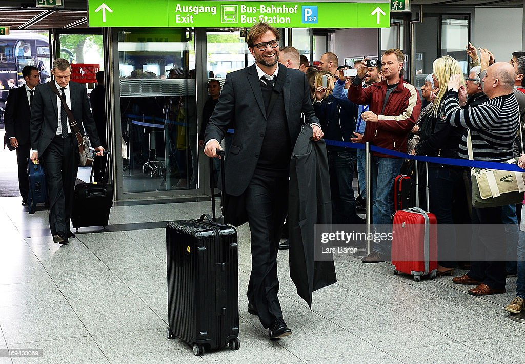 Head coach Juergen Klopp of Borussia Dortmund boards a plane during their departure at Dortmund Airport on the eve of the UEFA Champions League Final on May 24, 2013 in Dortmund, Germany.