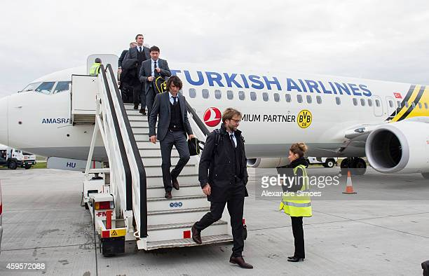 Head coach Juergen Klopp of Borussia Dortmund comes out of the airplane at the London airport prior to their UEFA Champions League match against FC...