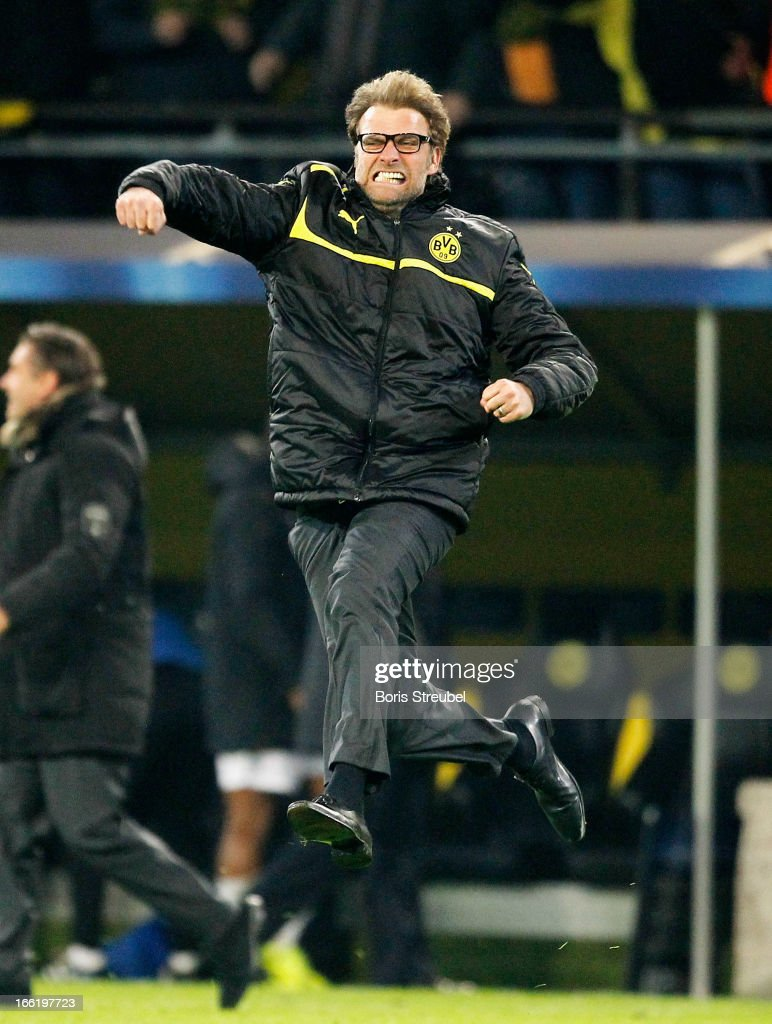 Head Coach Juergen Klopp of Borussia Dortmund runs onto the pitch to celebrate victory at the final whistle after the UEFA Champions League quarter-final second leg match between Borussia Dortmund and Malaga at Signal Iduna Park on April 9, 2013 in Dortmund, Germany.