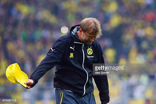 Head coach Juergen Klopp of Dortmund bows in front of the fans after the Bundesliga match between Borussia Dortmund and Werder Bremen at Signal Iduna...