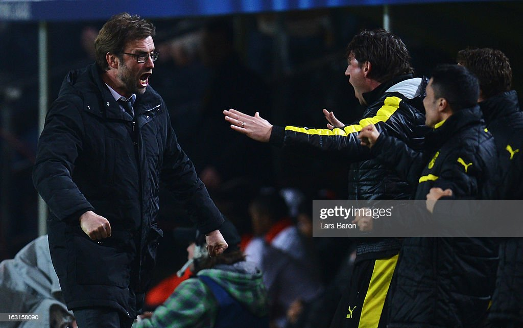 Head coach Juergen Klopp of Dortmund celebrates after Felipe Santana scores his teams first goal during the UEFA Champions League round of 16 second leg match between Borussia Dortmund and Shakhtar Donetsk at Signal Iduna Park on March 5, 2013 in Dortmund, Germany.