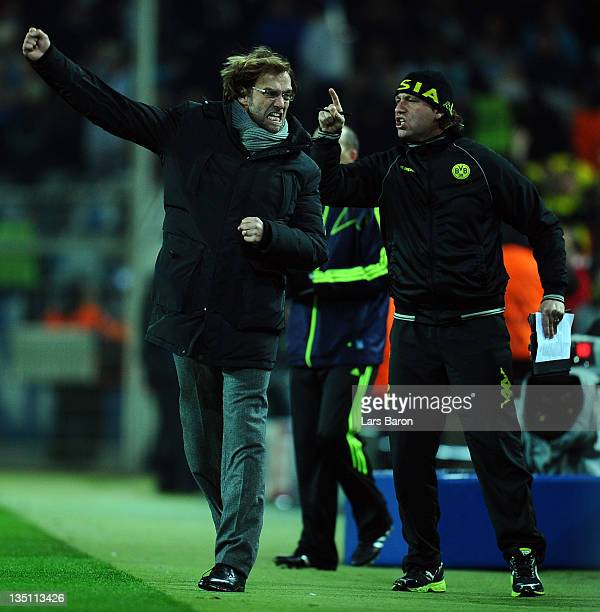 Head coach Juergen Klopp of Dortmund celebrates after Jakub Blaszczykowski scored his teams first goal during the UEFA Champions League group F match...