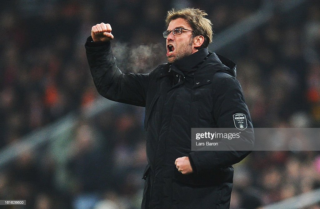 Head coach Juergen Klopp of Dortmund celebrates after Robert Lewandowski scored his teams first goal during the UEFA Champions League Round of 16 first leg match between Shakhtar Donetsk and Borussia Dortmund at Donbass Arena on February 13, 2013 in Donetsk, Ukraine.
