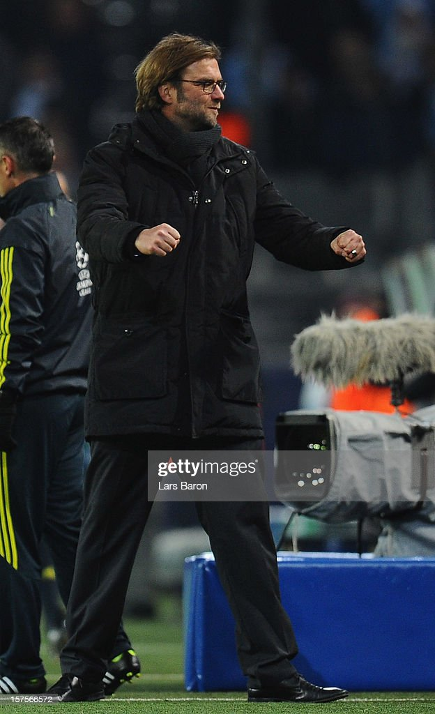 Head coach Juergen Klopp of Dortmund celebrates after winning the UEFA Champions League group D match between Borussia Dortmund and Manchester City at Signal Iduna Park on December 4, 2012 in Dortmund, Germany.