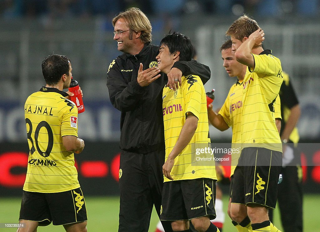 Head coach Juergen Klopp of Dortmund celebrates the 31 victory with Shinji Kagawa after the preseason friendly match between Borussia Dortmund and...