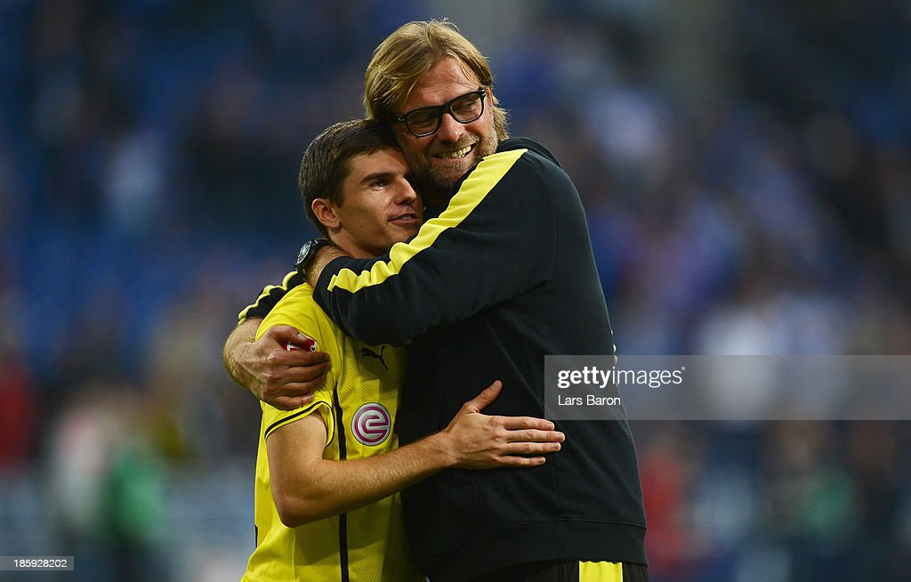 Head coach Juergen Klopp of Dortmund celebrates with Jonas Hofmann after winning the Bundesliga match between FC Schalke 04 and Borussia Dortmund at Veltins-Arena on October 26, 2013 in Gelsenkirchen, Germany.