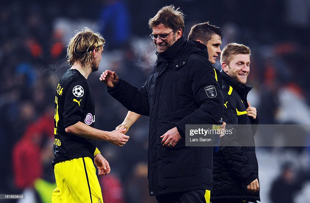 Head coach Juergen Klopp of Dortmund celebrates with MArcel Schmelzer after winning the UEFA Champions League Round of 16 first leg match between Shakhtar Donetsk and Borussia Dortmund at Donbass Arena on February 13, 2013 in Donetsk, Ukraine.