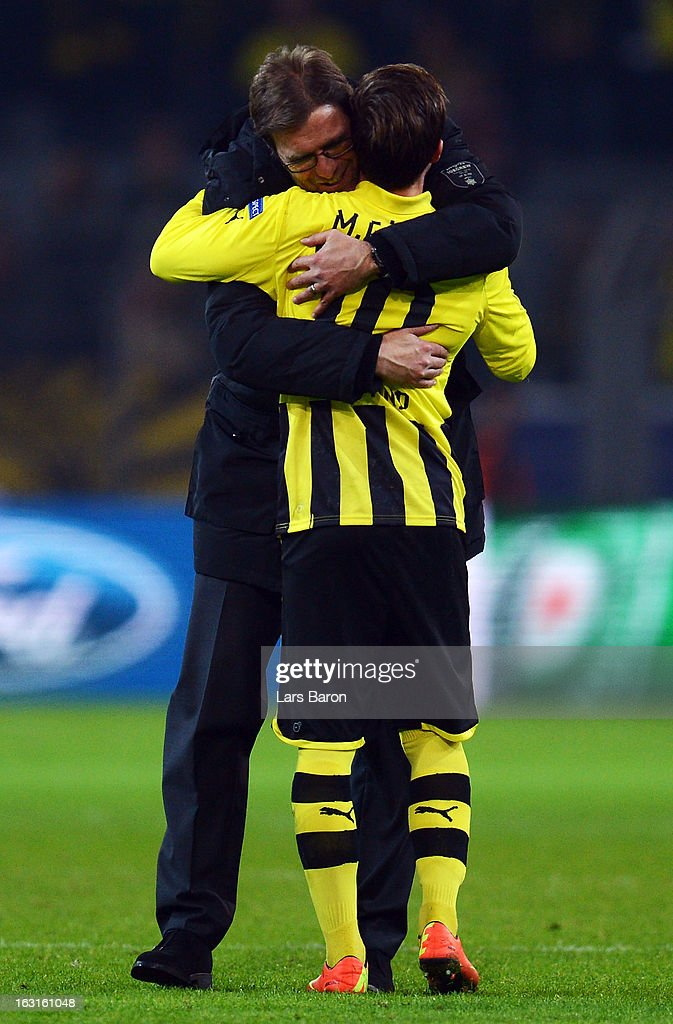 Head coach Juergen Klopp of Dortmund celebrates with Mario Goetze after winning the UEFA Champions League round of 16 second leg match between Borussia Dortmund and Shakhtar Donetsk at Signal Iduna Park on March 5, 2013 in Dortmund, Germany.