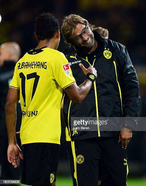 Head coach Juergen Klopp of Dortmund celebrates with Pierre Aubameyang after winning the Bundesliga match between Borussia Dortmund and Hamburger SV...