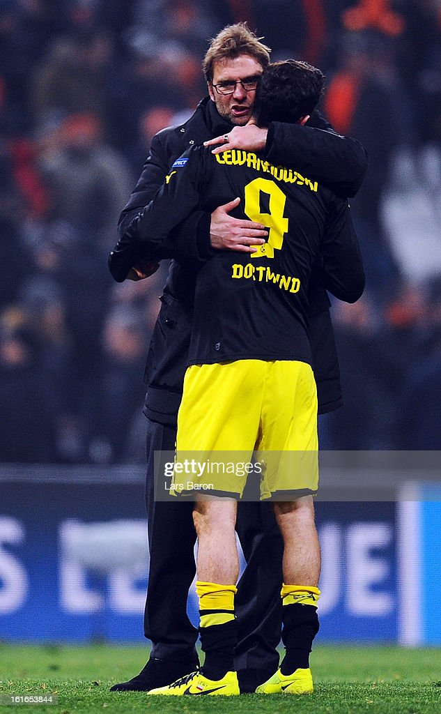 Head coach Juergen Klopp of Dortmund celebrates with <a gi-track='captionPersonalityLinkClicked' href=/galleries/search?phrase=Robert+Lewandowski&family=editorial&specificpeople=5532633 ng-click='$event.stopPropagation()'>Robert Lewandowski</a> after winning the UEFA Champions League Round of 16 first leg match between Shakhtar Donetsk and Borussia Dortmund at Donbass Arena on February 13, 2013 in Donetsk, Ukraine.
