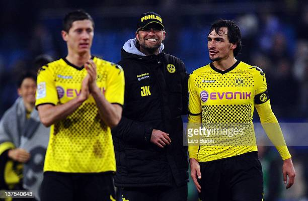 Head coach Juergen Klopp of Dortmund celebrates with Robert Lewandowski and Mats Hummels after winning the Bundesliga match between Hamburger SV and...