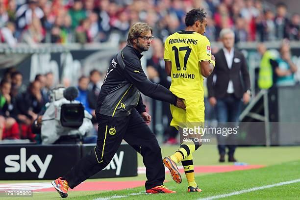 Head coach Juergen Klopp of Dortmund claps PierreEmerick Aubameyang during the Bundesliga match between Eintracht Frankfurt and Borussia Dortmund at...