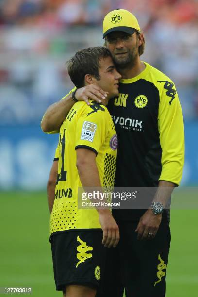 Head coach Juergen Klopp of Dortmund embraces Mario Goetze after winning 40 the Bundesliga match between Borussia Dortmund and FC Ausgburg at Signal...