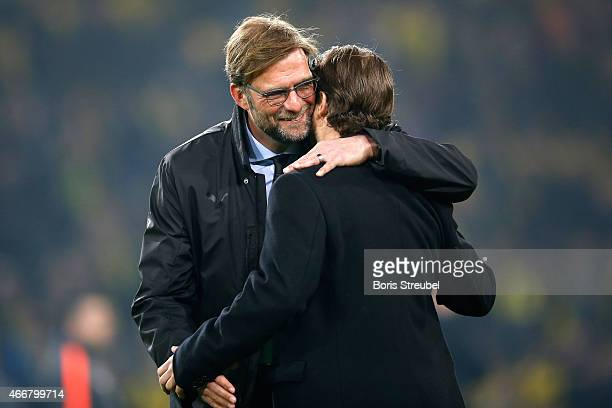 Head coach Juergen Klopp of Dortmund hugs Lars Ricken prior to the UEFA Champions League Round of 16 second leg match between Borussia Dortmund and...
