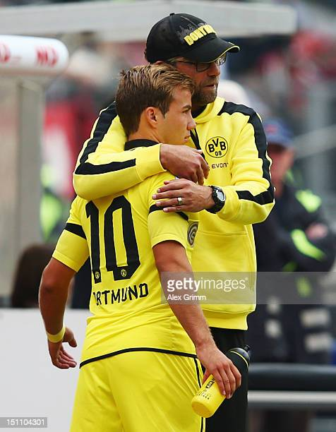 Head coach Juergen Klopp of Dortmund hugs Mario Goetze during the Bundesliga match between 1 FC Nuernberg and Borussia Dortmund at Easy Credit...