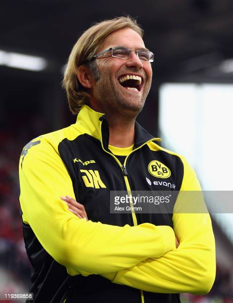Head coach Juergen Klopp of Dortmund laughs before the LIGA total Cup semifinal match between FSV Mainz 05 and Borussia Dortmund at Coface Arena on...
