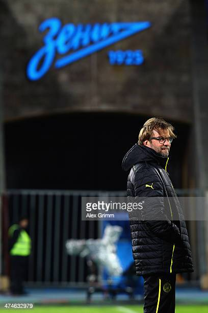 Head coach Juergen Klopp of Dortmund looks on during a training session ahead of the UEFA Champions League Round of 16 first leg match between FC...