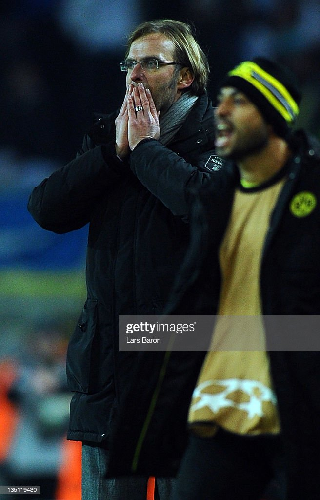 Head coach Juergen Klopp of Dortmund reacts after Sebastian Kehl get challenged by Stephane Mbia of Marseille during the UEFA Champions League group F match between Borussia Dormtund and Olympique de Marseille at Signal Iduna Park on December 6, 2011 in Dortmund, Germany.