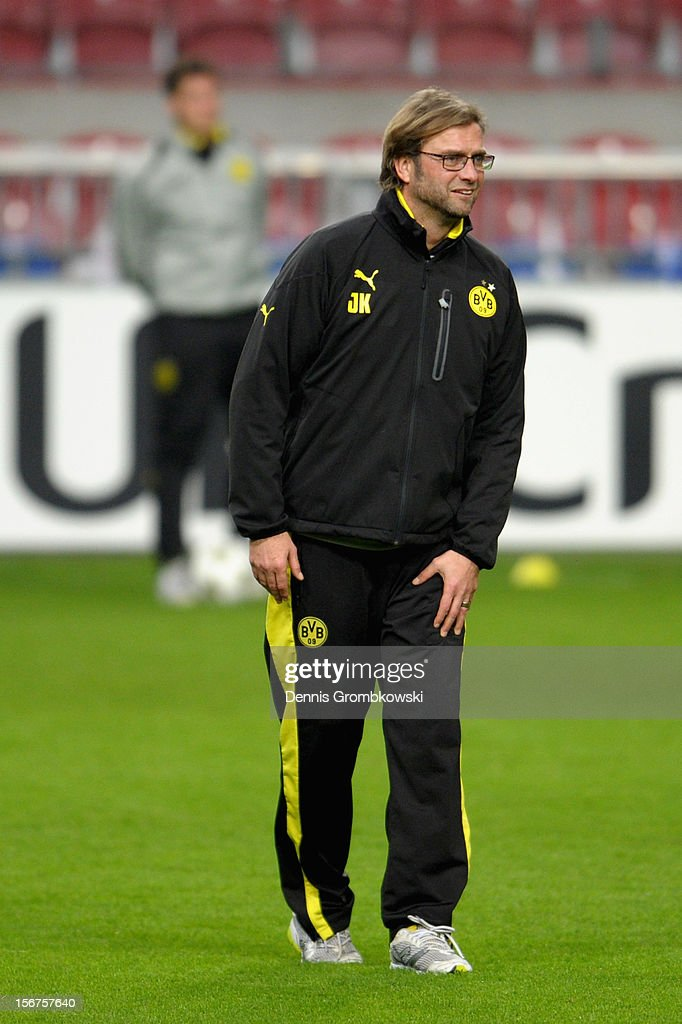Head coach <a gi-track='captionPersonalityLinkClicked' href=/galleries/search?phrase=Juergen+Klopp&family=editorial&specificpeople=739056 ng-click='$event.stopPropagation()'>Juergen Klopp</a> of Dortmund reacts during a training session ahead of the UEFA Champions League match against Ajax Amsterdam on November 20, 2012 in Amsterdam, Netherlands.