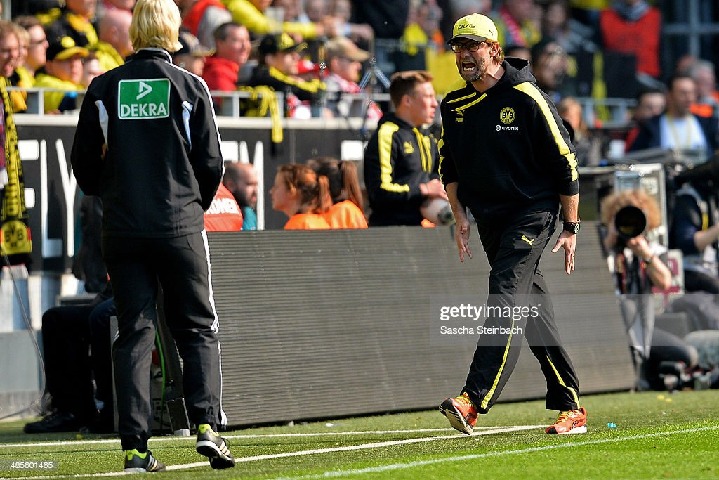 Head coach Juergen Klopp (R) of Dortmund reacts towards fourth official referee <a gi-track='captionPersonalityLinkClicked' href=/galleries/search?phrase=Bibiana+Steinhaus&family=editorial&specificpeople=2299795 ng-click='$event.stopPropagation()'>Bibiana Steinhaus</a> (L) during the Bundesliga match between Borussia Dortmund v 1. FSV Mainz 05 at Signal Iduna Park on April 19, 2014 in Dortmund, Germany.