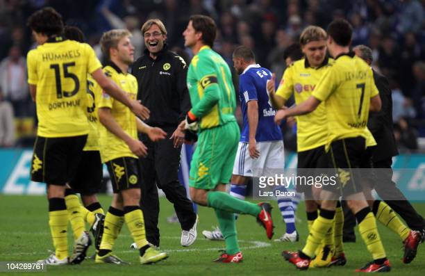 Head coach Juergen Klopp of Dortmund smiles with his players after winning the Bundesliga match between FC Schalke 04 and Borussia Dortmund at...