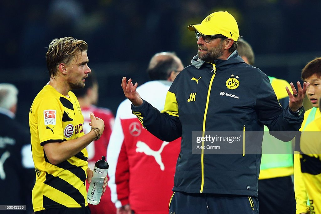 Head coach Juergen Klopp of Dortmund talks to <a gi-track='captionPersonalityLinkClicked' href=/galleries/search?phrase=Marcel+Schmelzer&family=editorial&specificpeople=5443925 ng-click='$event.stopPropagation()'>Marcel Schmelzer</a> after the Bundesliga match between Borussia Dortmund and VfB Stuttgart at Signal Iduna Park on September 24, 2014 in Dortmund, Germany.